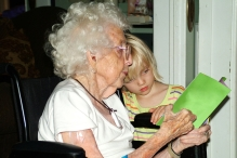reading-with-grandmother-in-wheelchair-1432646